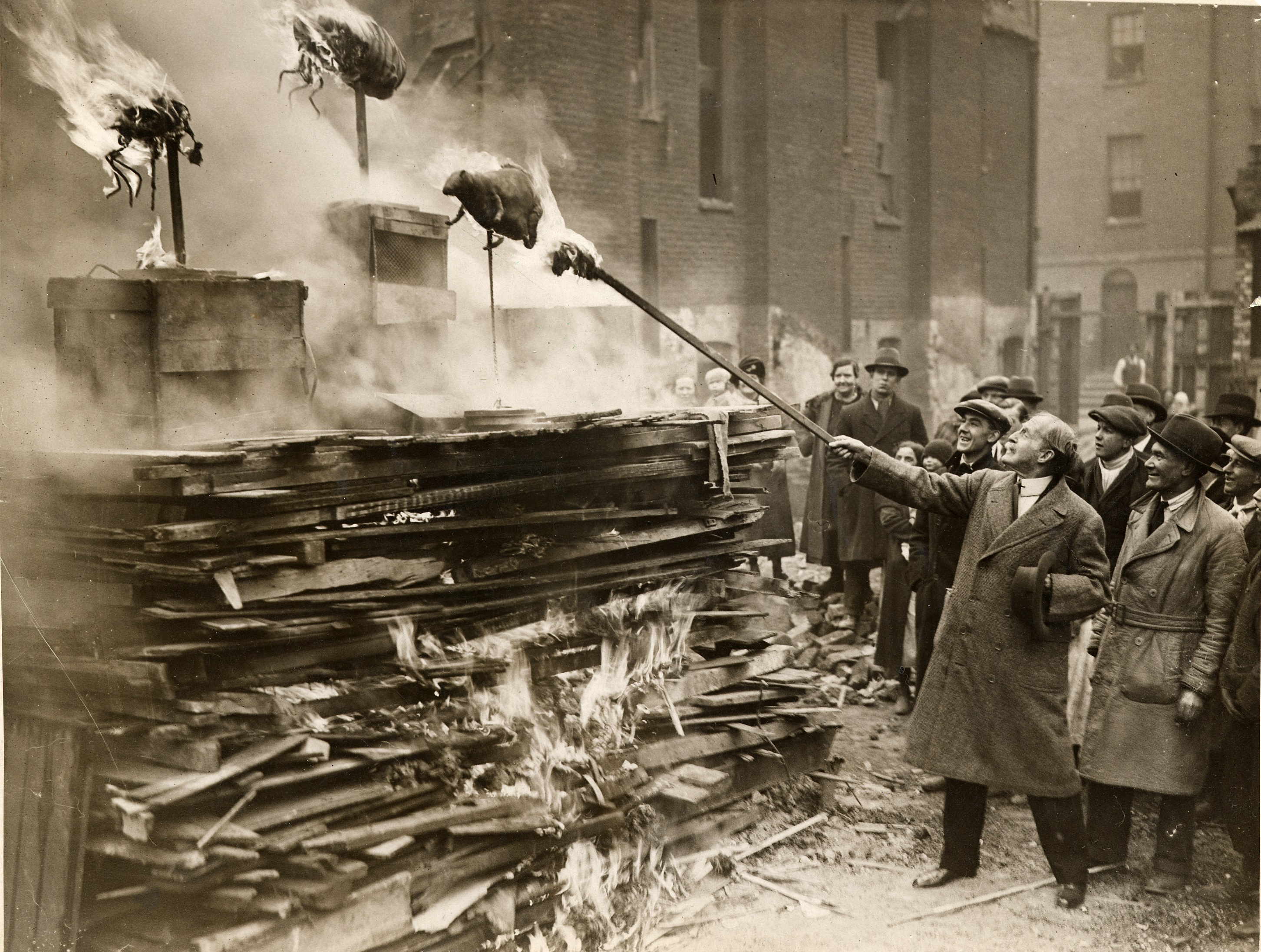 Ceremonial burning of models of bugs at the opening of St Christopher's Flats in Somers Town in 1931